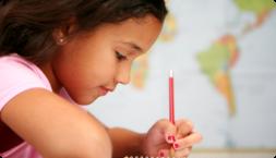 child focused on writing